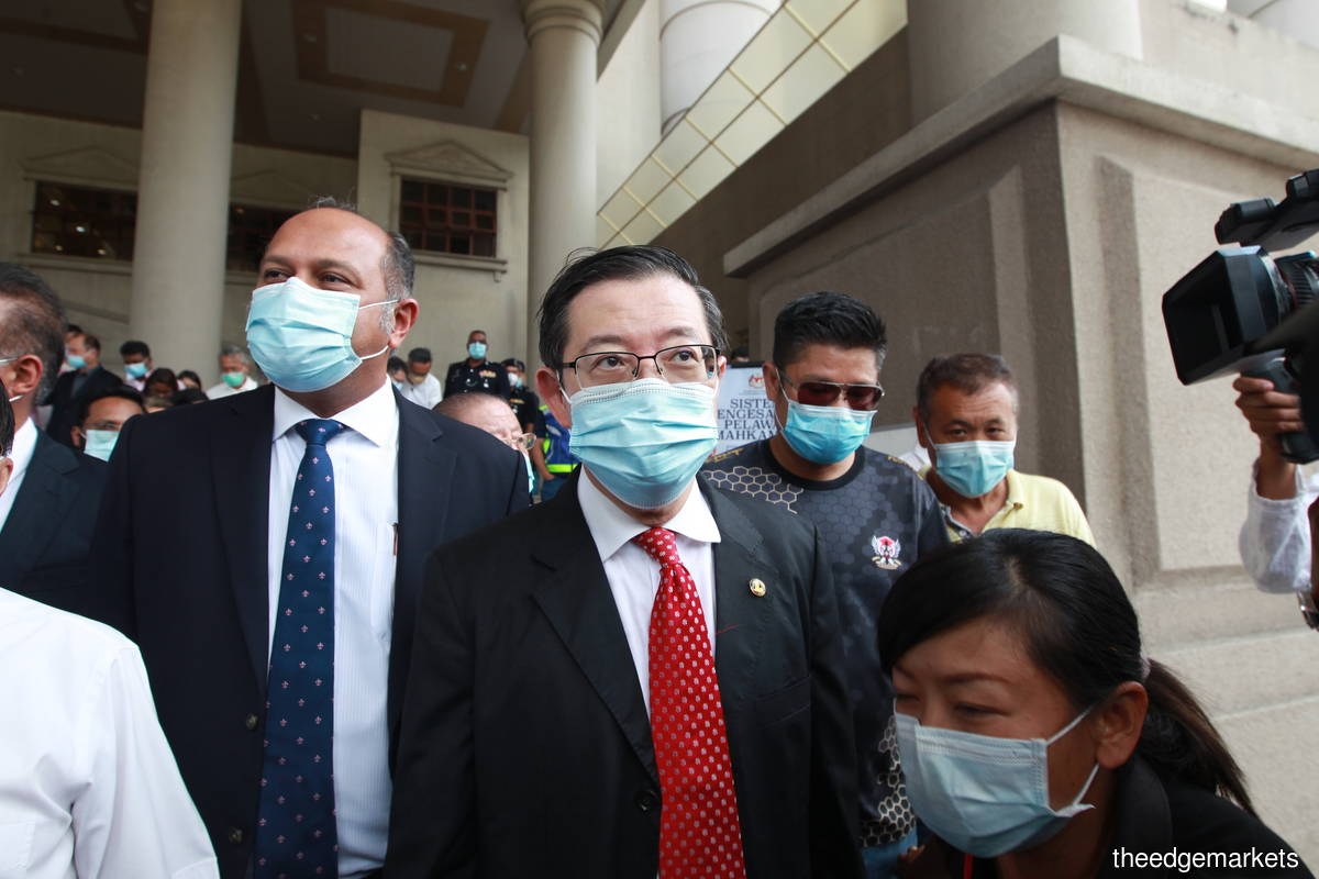 Guan Eng claims trial to two charges of misappropriation of property